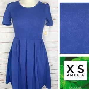 XS Amelia blue solid with subtle floral print